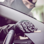 Car thief taking valuables - TrackerFit